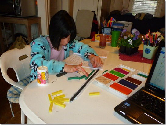 Lilly Working on Multiplication with Rods.